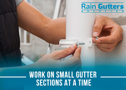 Cleaning and Repairing Rain Gutters Attaching Downspout