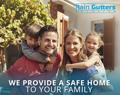 : A Happy Family After a Miami Rain Gutter Company Installed New Rain Gutters on Their Home's Roof